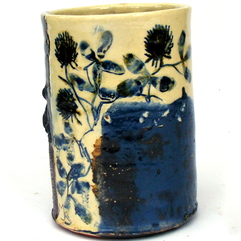 small cylinder with clover and rust