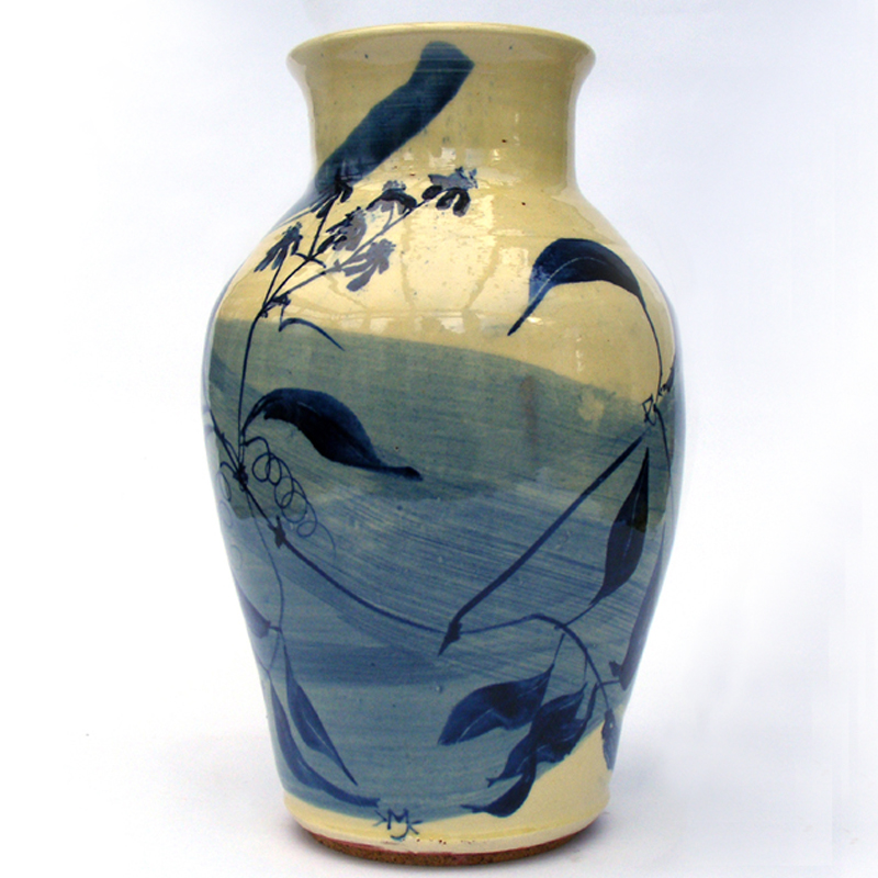 Vase with blue cobalt clematis