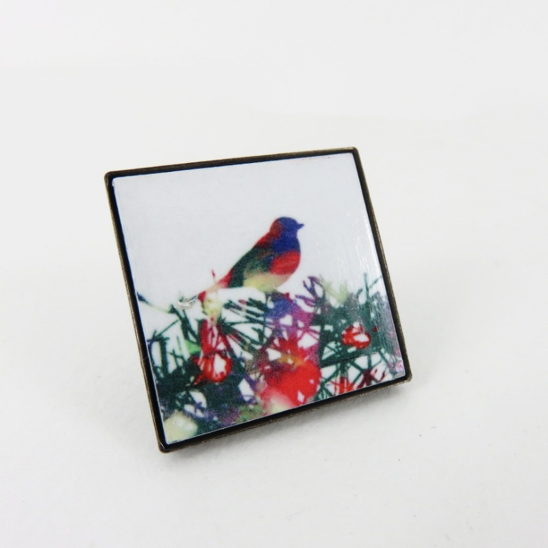Bird in a bush brooch