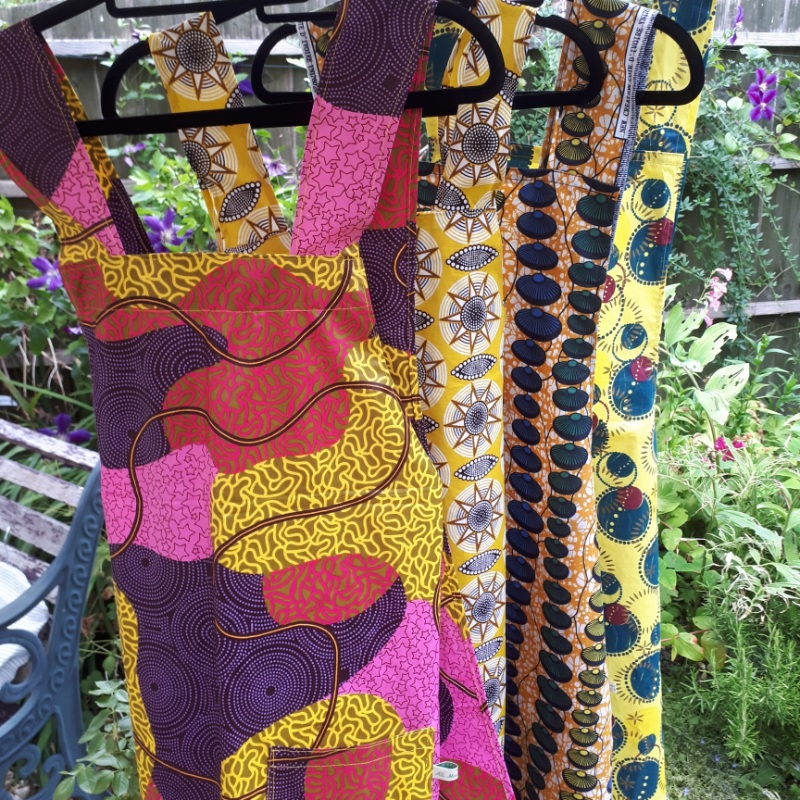 Japanese style cross back aprons in vibrant African print